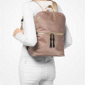 7d49152284fd Michael Kors Bags - NWT Michael Kors Polly Slim Backpack Dune/Gold